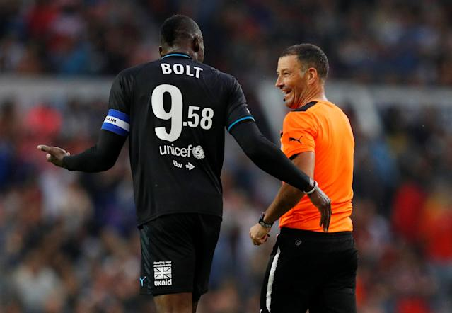 Soccer Football - Soccer Aid 2018 - England v Soccer Aid World XI - Old Trafford, Manchester, Britain - June 10, 2018 World XI's Usain Bolt with referee Mark Clattenburg REUTERS/Phil Noble