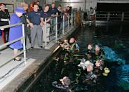 <p>In 2007, the monarch paid a visit to the top-secret set of the James Bond film, chatting with the divers working at the underwater stage at the Pinewood Studios in Iver Heath, England. </p>