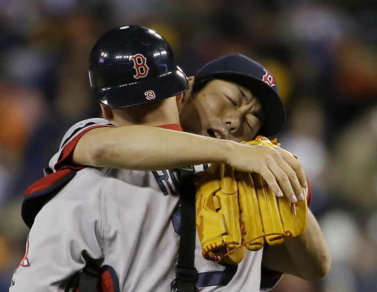 Boston Red Sox's Koji Uehara celebrates with David Ross after the Red Sox defeating the Detroit Tigers 4-3 in Game 5 of the American League baseball championship series Thursday, Oct. 17, 2013, in Detroit. (AP Photo/Matt Slocum)