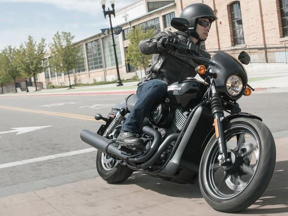 a person riding a harley davidson street 750 motorcycle on a city street