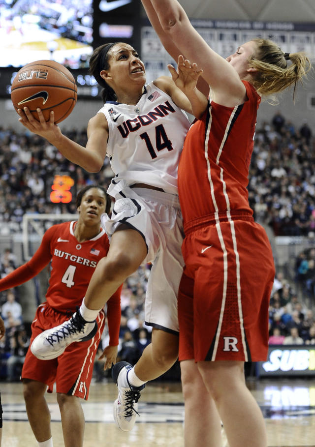 Connecticut's Bria Hartley drives to the basket and is fouled by Rutgers' Christa Evans, right, during the first half an NCAA college basketball game, Saturday, March 1, 2014, in Storrs, Conn. (AP Photo/Jessica Hill)