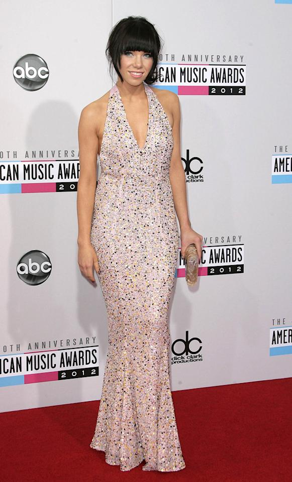 AMAs 2012: Carly Rae Jepsen picked up the gong for best new artist, and looked totally stunning on the red carpet, too. Carly wore a full length pale pink halter-neck dress covered with bead embellishment. Copyright [WENN]