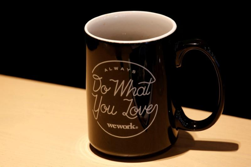 FILE PHOTO - A mug bears the name of WeWork is seen at its flagship location in Hong Kong