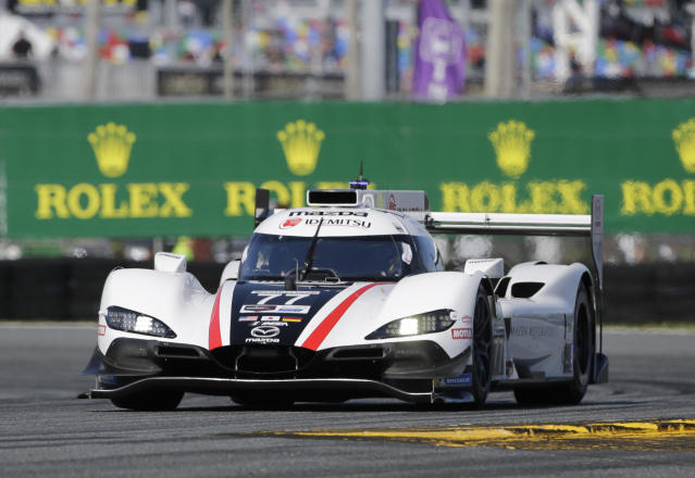 Oliver Jarvis (77) Mazda Dpi leads the race early in the Rolex 24 hour auto race at Daytona International Speedway, Saturday, Jan. 25, 2020, in Daytona Beach, Fla. (AP Photo/Terry Renna)