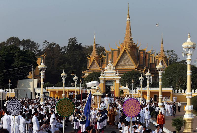 The funeral procession of the late former Cambodian King Norodom Sihanouk leaves the Royal Palace in Phnom Penh, Friday, Feb. 1, 2013. Thousands of mourners accompanied the gilded chariot carrying the body of former King Sihanouk - the dominant figure of modern Cambodia - in the funeral procession Friday to a cremation ground next to the palace where he was crowned more than 70 years ago. (AP Photo/Wong Maye-E)