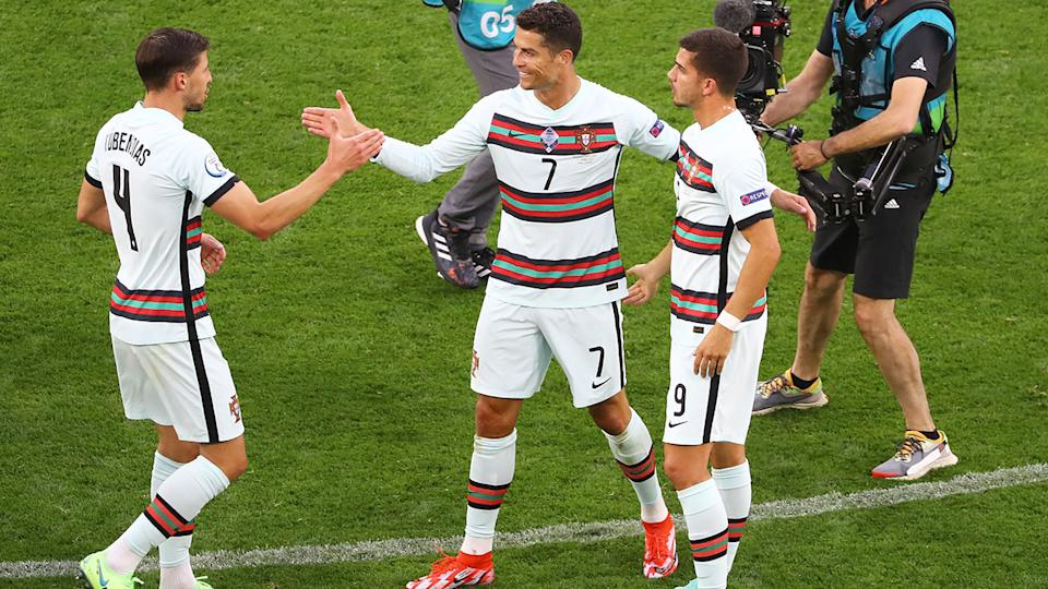 Cristiano Ronaldo, pictured here celebrating with teammates after Portugal beat Hungary at Euro 2020.