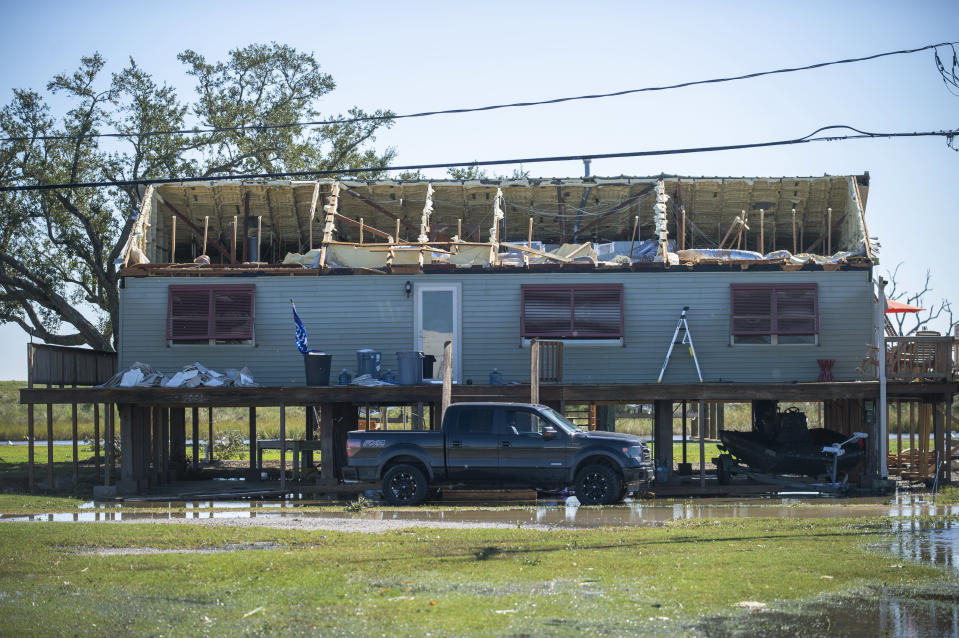 A house is damaged from Hurricane Zeta in Cocodrie, La., Thursday, Oct. 29, 2020. Gov. John Bel Edwards says officials are still assessing the extent of Zeta's damage across the southeastern parishes. (Chris Granger/The Advocate via AP)