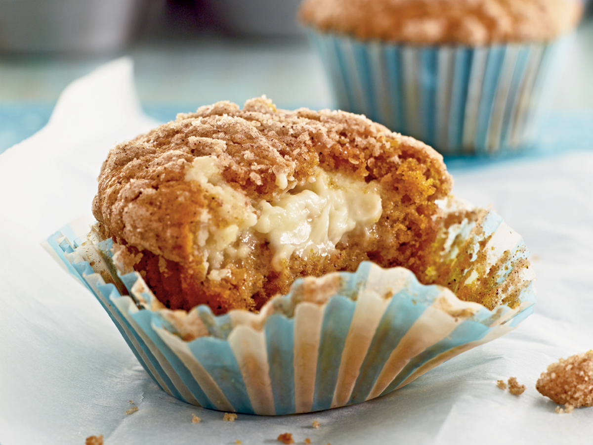 """<p>These pumpkin cream cheese muffins were made for the perfect first bite, with a crumbly streusel topping with a melted cream cheese morsel right in the center. The cream cheese filling ensures these pumpkin muffins stay moist and delightful up until the minute they're devoured—no butter spread necessary. Whether you're making these for company or to satisfy your own sweet tooth, these pumpkin cream cheese muffins are the perfect treat for fall mornings.</p> <p><a href=""""https://www.myrecipes.com/recipe/pumpkin-cream-cheese-muffins"""">Pumpkin-Cream Cheese Streusel Muffins Recipe</a></p>"""