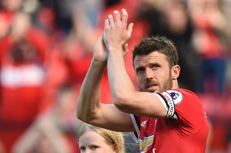 Michael Carrick applauds the Old Trafford crowd at the end of the English Premier League match between Manchester United and Watford