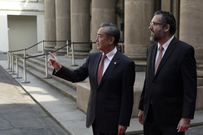 Brazil's Foreign Minister Ernesto Araujo receives China's Foreign Minister Wang Yi, left, during a welcome photo session as part of the BRICS representatives meeting in Rio de Janeiro, Brazil, Friday, July 26, 2019. BRICS is a grouping of major emerging economies encompassing Brazil, Russia, India, China and South Africa. (AP Photo/Leo Correa)