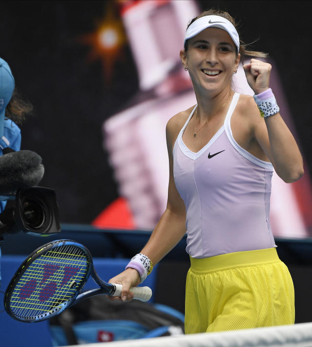 Switzerland's Belinda Bencic celebrates after defeating Latvia's Jelena Ostapenko during their second round singles match at the Australian Open tennis championship in Melbourne, Australia, Thursday, Jan. 23, 2020. (AP Photo/Andy Brownbill)