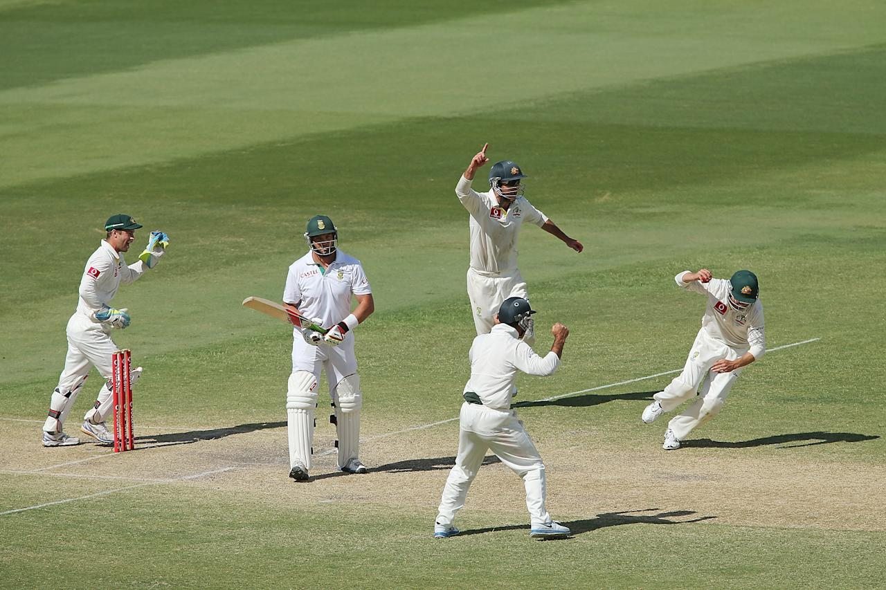 ADELAIDE, AUSTRALIA - NOVEMBER 26: Jacques Kallis of South Africa is cought out by Ed Cowan of Australia as Australian players celebrate during day five of the Second Test Match between Australia and South Africa at Adelaide Oval on November 26, 2012 in Adelaide, Australia.  (Photo by Morne de Klerk/Getty Images)