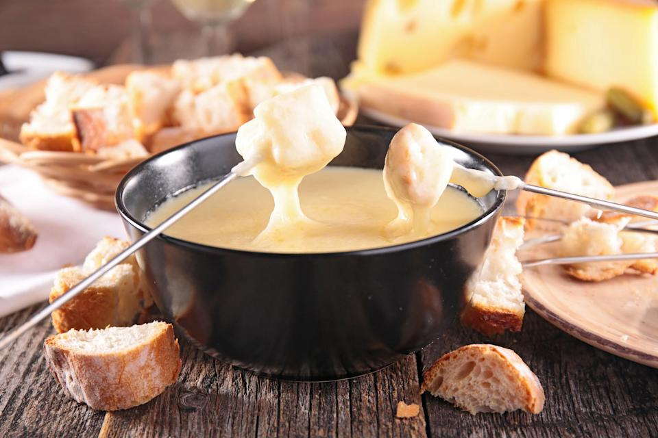 """The beloved Swiss national dish consists of cheese melted down with white wine in a """"caquelon"""" pot heated by an open flame."""