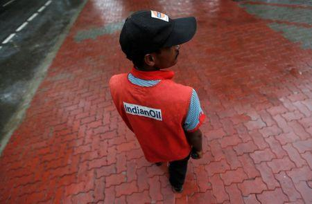 A private security guard wearing a jacket of Indian Oil stands outside a fuel station in New Delhi, August 29, 2016. REUTERS/Adnan Abidi/Files
