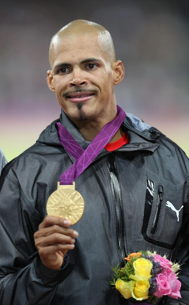 LONDON, ENGLAND - AUGUST 06: Gold medalist Felix Sanchez of Dominican Republic reacts on the podium during the medal ceremony for the Men's 400m Hurdles final on Day 10 of the London 2012 Olympic Games at the Olympic Stadium on August 6, 2012 in London, England. (Photo by Clive Brunskill/Getty Images)