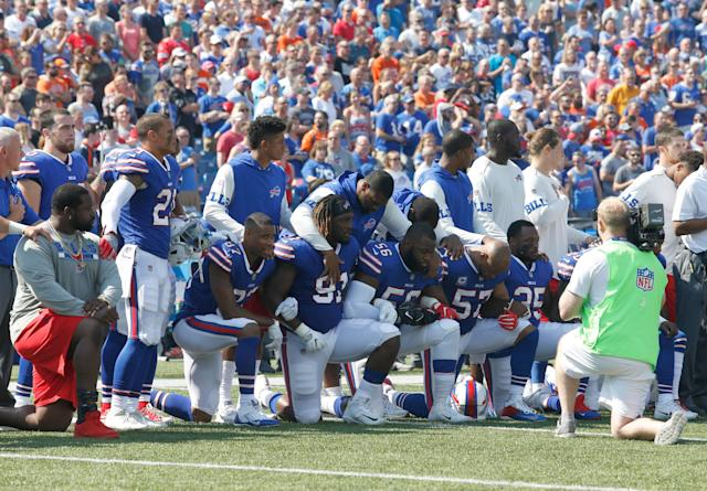 Buffalo Bills players kneel in protest during the national anthem before a game in New York against the Denver Broncos on Sunday.