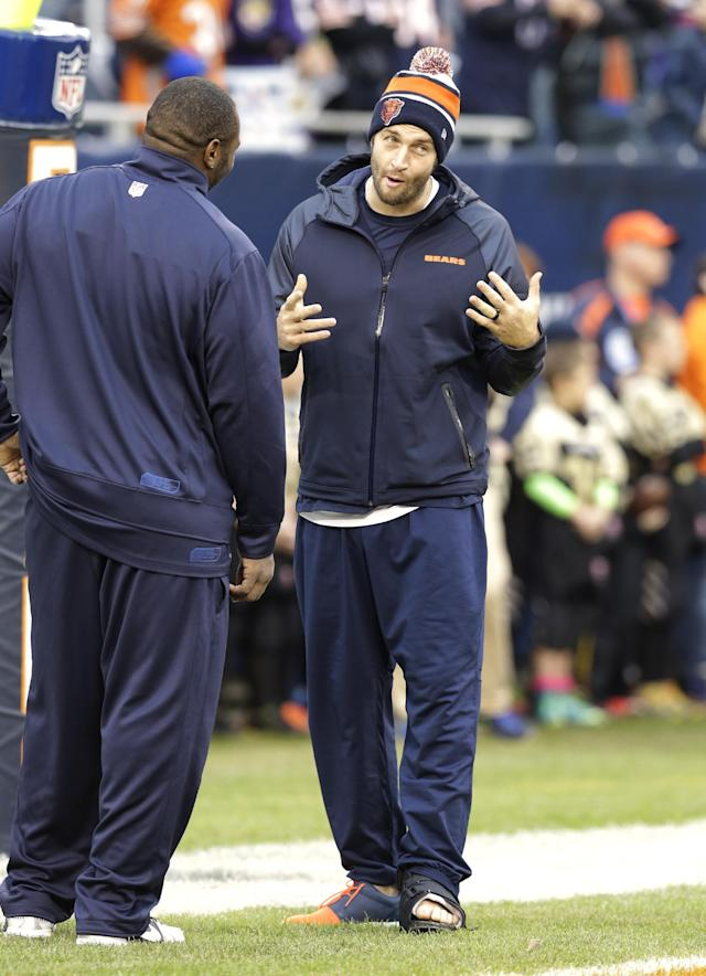 Injured Chicago Bears quarterback Jay Cutler, right, talks with a teammate before an NFL football game against the Baltimore Ravens, Sunday, Nov. 17, 2013, in Chicago. (AP Photo/Nam Y. Huh)