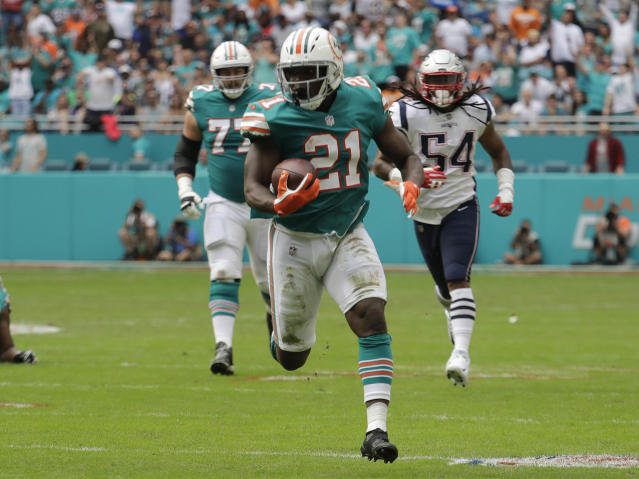 Miami Dolphins running back Frank Gore (21) will reportedly miss the rest of this season with a mid-foot sprain. (AP)