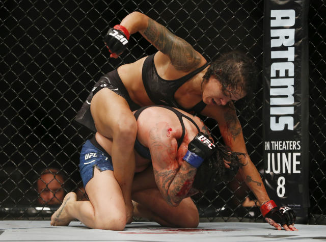 Raquel Pennington fully supported her corner's decision to compel her to keep fighting at UFC 224 despite the bloody beating she suffered. (AP)