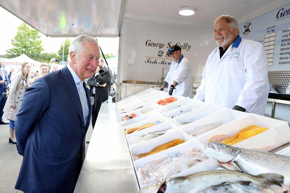<p>Prince Charles makes eye contact with a fish at the Bangor open air market during a trip to Northern Ireland. </p>