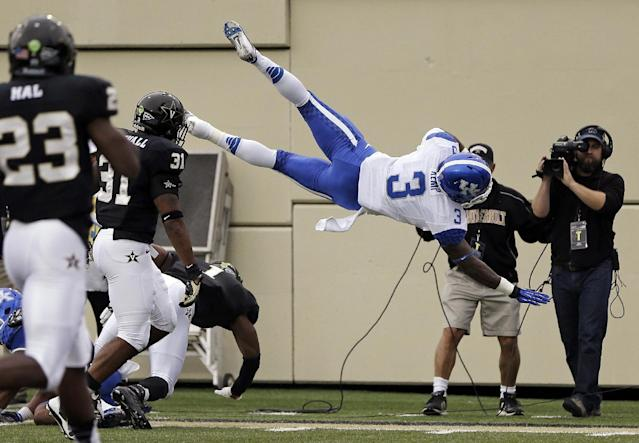 Kentucky running back Jojo Kemp (3) is knocked out-of-bounds at the 2-yard line in the first quarter of an NCAA college football game against Vanderbilt on Saturday, Nov. 16, 2013, in Nashville, Tenn. (AP Photo/Mark Humphrey)