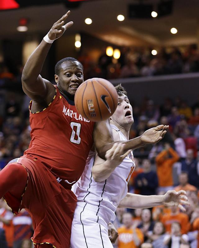 Maryland forward Charles Mitchell (0) goes for a rebound with Virginia forward/center Mike Tobey, right, during the first half of an NCAA college basketball game in Charlottesville, Va., Monday, Feb. 10, 2014. (AP Photo/Steve Helber)