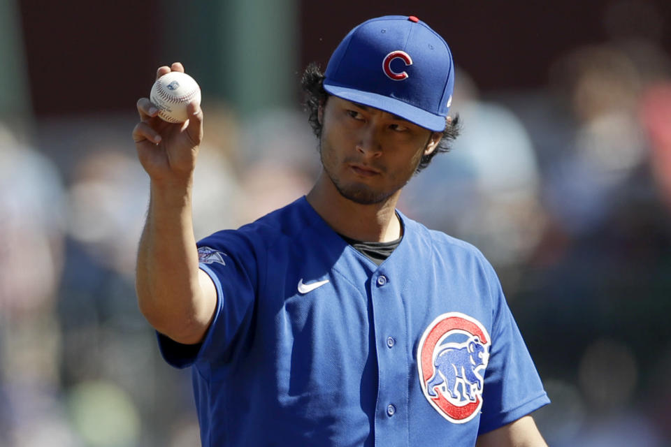 Chicago Cubs starting pitcher Yu Darvish motions as he works against a Milwaukee Brewers batter during the first inning of a spring training baseball game Saturday, Feb. 29, 2020, in Mesa, Ariz. (AP Photo/Gregory Bull)