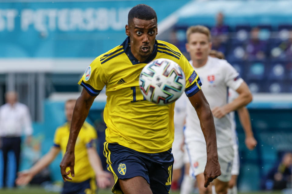 Sweden's Alexander Isak keeps his eyes on the ball during the Euro 2020 soccer championship group E match between Sweden and Slovakia, at the Saint Petersburg stadium, in Saint Petersburg, Russia, Friday, June 18, 2021. (Anatoly Maltsev, Pool via AP)