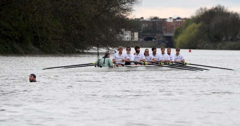 The Boat Race is halted as a swimmer interrupts the 158th Boat Race on the river Thames, London, Saturday April 7, 2012. Cambridge won a dramatic Boat Race against Oxford on Saturday following a 31-minute mid-race postponement after a man jumped into the River Thames and swam between the crews. When the race was restarted halfway along the course, Oxford's German rower Dr. Hanno Wienhausen lost half of his oar after the crews clashed allowing Cambridge to cruise to victory up against effectively seven opponents. A margin of victory wasn't given by officials. (AP Photo/PA, Anthony Devlin) UNITED KINGDOM OUT