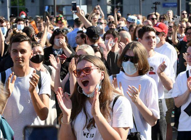 PHOTO: People react after the announcement of the verdict in the embezzlement trial against Russian theatre and film director Kirill Serebrennikov outside a court building in Moscow on June 26, 2020. (Kirill Kudryavtsev/AFP via Getty Images)