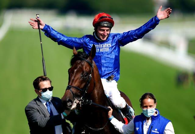 Adam Kirby celebrates on top of Adayar after winning the Cazoo Derby during day two of the Cazoo Derby Festival at Epsom Racecourse