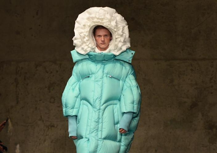 Chen Peng won rave applause for his catwalk collection of giant puffer coats, puffer-style flower hats and ornamental handbags in the shape of a dog (AFP Photo/TIMOTHY A. CLARY)