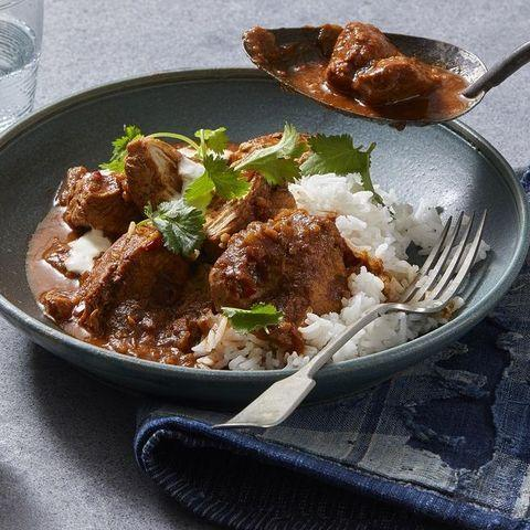 """<p>This savory Indian favorite actually heats up super well. Save on delivery by making it yourself!</p><p><em><a href=""""https://www.goodhousekeeping.com/food-recipes/a7386/chicken-curry/"""" target=""""_blank"""">Get the recipe for Traditional Chicken Curry »</a></em></p>"""