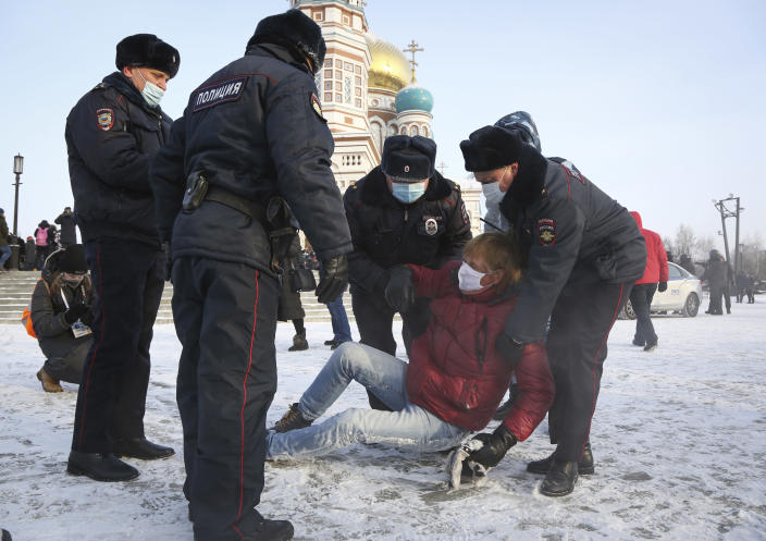 Police detain a man during a protest against the jailing of opposition leader Alexei Navalny in Siberian city of Omsk, Russia, Saturday, Jan. 23, 2021. Russian police on Saturday arrested hundreds of protesters who took to the streets in temperatures as low as minus-50 C (minus-58 F) to demand the release of Alexei Navalny, the country's top opposition figure. Navalny, President Vladimir Putin's most prominent foe, was arrested on Jan. 17 when he returned to Moscow from Germany, where he had spent five months recovering from a severe nerve-agent poisoning that he blames on the Kremlin (AP Photo)