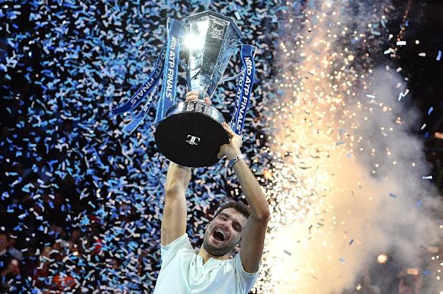 Bulgaria's Grigor Dimitrov celebrates winning the ATP World Tour Finals (AFP Photo/Glyn KIRK )