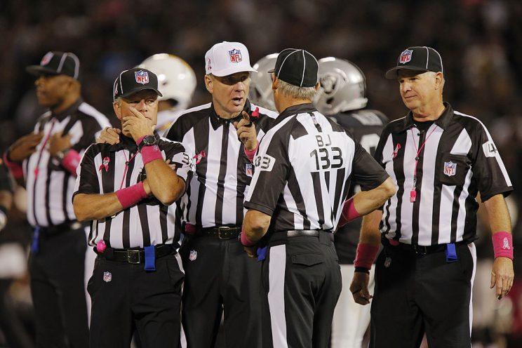 The days of refs discussing penalties forever could be coming to an end. (Getty)