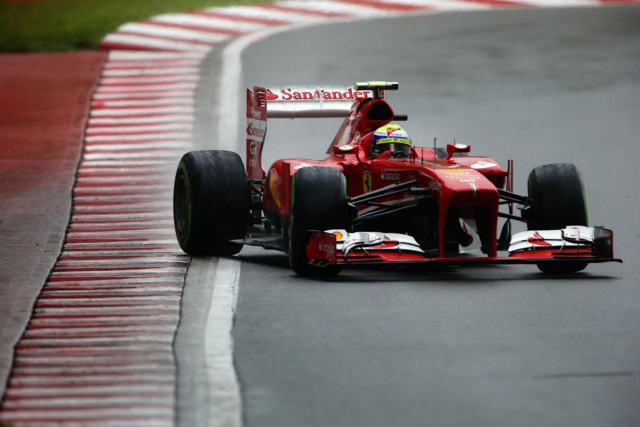 MONTREAL, QC - JUNE 08:  Felipe Massa of Brazil and Ferrari drives during qualifying for the Canadian Formula One Grand Prix at the Circuit Gilles Villeneuve on June 8, 2013 in Montreal, Canada.  (Photo by Paul Gilham/Getty Images)