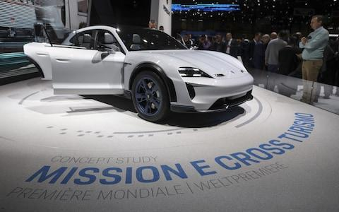 A Porsche AG Mission E hybrid automobile stands on display on day two of the 88th Geneva International Motor Show in Geneva, Switzerland - Credit: Chris Ratcliffe/Bloomberg