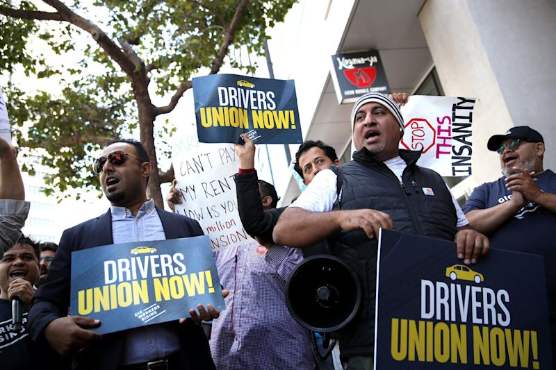 Drivers hold signs during a protest outside Uber headquarters in support of California Assembly Bill 5, Aug. 27, 2019, in San Francisco. (Photo: Justin Sullivan via Getty Images)