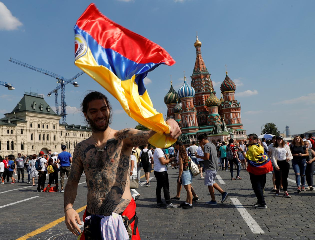 A supporter of the Colombian national soccer team waves a flag in front of St. Basil's Cathedral at Red Square in Moscow, Russia June 18, 2018. REUTERS/Tatyana Makeyeva