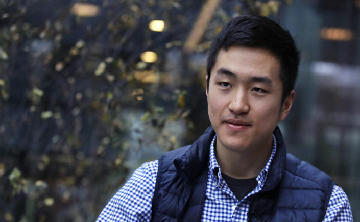 """FILE— In this Dec. 13, 2018 file photograph, Harvard University graduate and Rhodes Scholar Jin K. Park, who holds a degree in molecular and cellular biology, listens during an interview in Cambridge, Mass. Park, the first """"Dreamer"""" to be awarded a prestigious Rhodes Scholarship, finally is heading to England's University of Oxford this fall after 2 1/2 years of limbo brought on by the Trump administration's refusal to let DACA recipients travel abroad. (AP Photo/Charles Krupa, File)"""