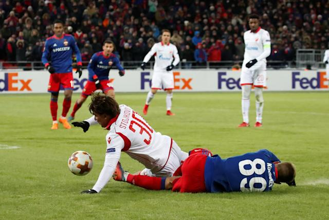 Soccer Football - Europa League Round of 32 Second Leg - CSKA Moscow vs Red Star Belgrade - VEB Arena, Moscow, Russia - February 21, 2018 CSKA Moscow's Konstantin Kuchaev in action with Red Star Belgrade's Filip Stojkovic REUTERS/Maxim Shemetov