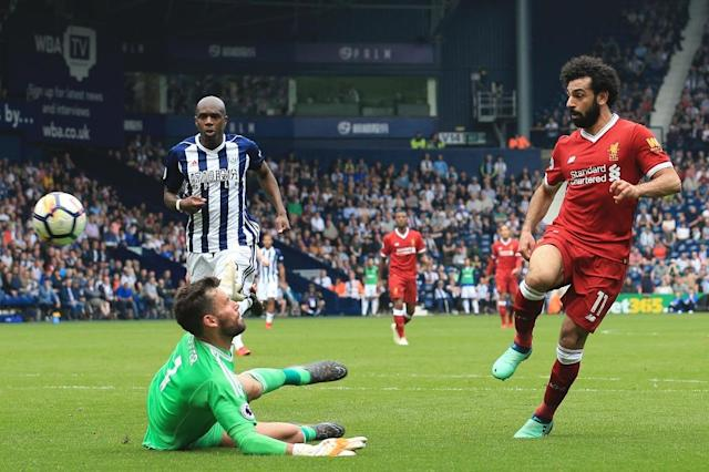 Salah matched the Premier League record for most goals in a 38-game season shared by Alan Shearer, Cristiano Ronaldo and Luis Suarez (AFP Photo/Lindsey PARNABY)