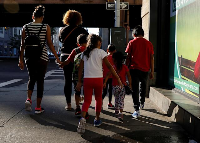 Children being escorted to a center that provides foster care and other services to immigrant children separated from their families, in New York City, July 2018. (Photo: Brendan McDermid/Reuters)