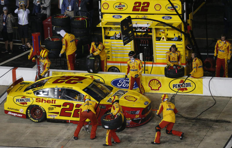 Joey Logano makes a pit stop during the NASCAR Cup Series auto race at Richmond Raceway in Richmond, Va., Saturday, April 13, 2019. (AP Photo/Steve Helber)