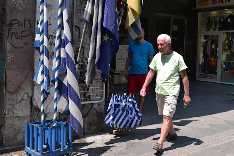 The debt-mired Greek economy expanded 0.8 percent in the second quarter, but analysts said that was an anomaly (AFP Photo/Louisa Gouliamaki)