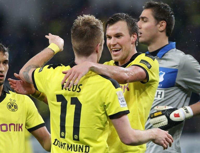 Dortmund's midfielder Kevin Grosskreutz (R) celebrates scoring the 2-1 with striker Marco Reus during the German first division Bundesliga football match against Hoffenheim in Sinsheim southwestern Germany, on December 16, 2012. Dortmund moved back up to third in the Bundesliga with a 3-1 win at strugglers Hoffenheim