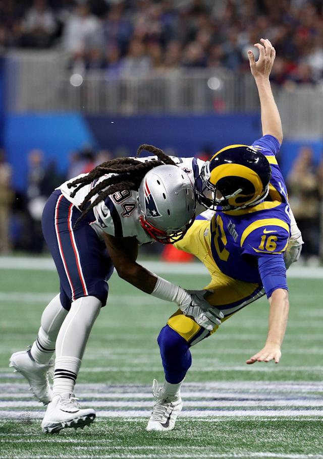 <p>Jared Goff #16 of the Los Angeles Rams is tackled by Adrian Clayborn #94 of the New England Patriots in the first quarter during Super Bowl LIII at Mercedes-Benz Stadium on February 03, 2019 in Atlanta, Georgia. (Photo by Al Bello/Getty Images) </p>