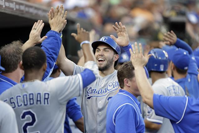 Kansas City Royals' Eric Hosmer celebrates with teammates after scoring on a Billy Butler three-run double in the fifth inning of a baseball game in Detroit, Monday, June 16, 2014. (AP Photo/Paul Sancya)