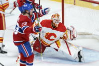 Montreal Canadiens' Tyler Toffoli celebrates his goal past Calgary Flames goaltender Jacob Markstrom during the second period of an NHL hockey game Friday, April 16, 2021, in Montreal. (Paul Chiasson/The Canadian Press via AP)
